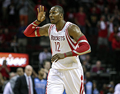 Dwight Howard celebrates while scoring 17 points and grabbing a career-high-tying 26 rebounds in his Houston debut. (USATSI)