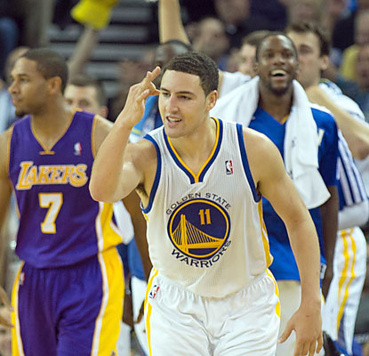 Klay Thompson, who scores a career-high 38 points, leads the Warriors to a memorable season-opening win over the Lakers. (USATSI)