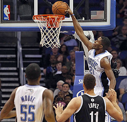 Magic small forward Maurice Harkless gets up for a dunk against the Nets. The 20-year-old scores 10 points. (USATSI)