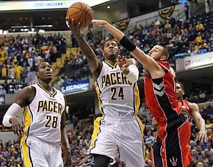 Indiana's Paul George goes up for 2 of his team-high 23 points around Toronto's Jonas Valanciunas. (USATSI)