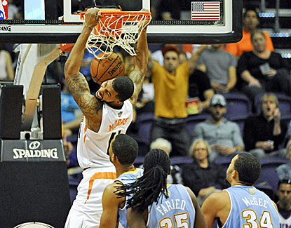 Phoenix's Markieff Morris scores 28 points, including 14 in the fourth quarter, to lead the Suns past Denver. (USATSI)
