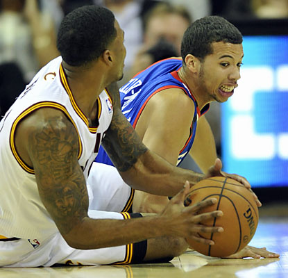 Michael Carter-Williams (21 points, 13 assists) and the Sixers don't do enough in a 2OT loss to Alonzo Gee and the Cavs. (USATSI)