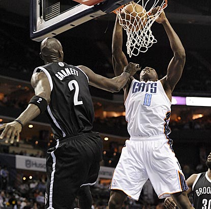 Brooklyn's Kevin Garnett can't stop Charlotte's Bismack Biyombo from dunking during the second half.  (USATSI)