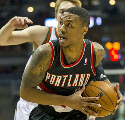 Damian Lillard helps the Blazers finish off a perfect East Coast road trip with their 10th win of the season.  (AP)