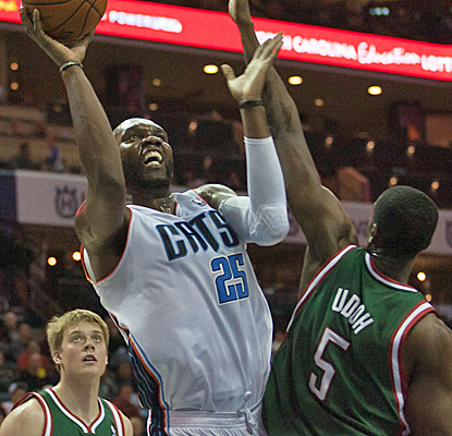 Al Jefferson earns his money on Friday, posting 23 points and 12 rebounds to help Charlotte down the Bucks.   (USATSI)