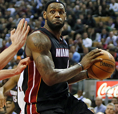 LeBron scores 27 points to go with Dwyane Wade's 22 as the Heat avoid a huge meltdown.  (USATSI)