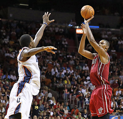 The Heat ride the hot hand of Chris Bosh, who scores 13 straight points, including three 3s, in the final minutes of action. (USATSI)