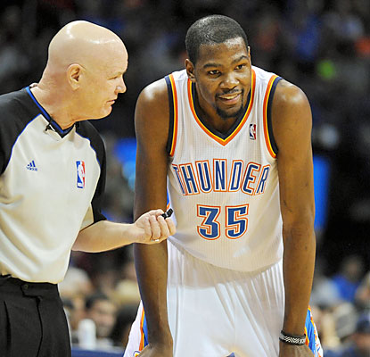 Kevin Durant (32 points, 12 assists, 10 rebounds) enjoys a moment with Joey Crawford as his Thunder improve to 9-0 at home. (USATSI)