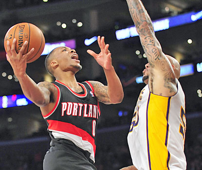 Damian Lillard (26 points, nine assists) helps the Blazers beat the Lakers on the road for the first time since April 2010. (USATSI)