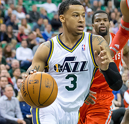 Rookie Trey Burke scores a career-high 21 points to help lift the Jazz past the streaking Rockets.  (USATSI)