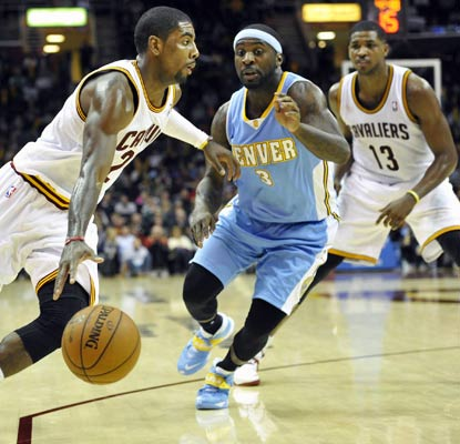 Kyrie Irving has 23 points and Tristan Thompson (13) adds 17 points and 21 rebounds to propel the Cavaliers past the Nuggets.  (USATSI)