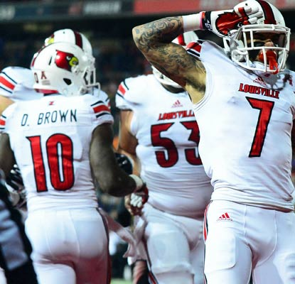 Damian Copeland catches a highlight-reel touchdown pass from Teddy Bridgewater in No. 19 Louisville's big win in Cincinnati.  (USATSI)