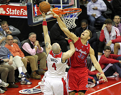 Blake Griffin goes for the block on Washington's Marcin Gortat in the Clippers' win over the Wizards. (USATSI)