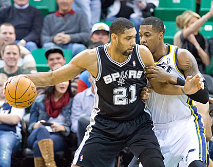 Tim Duncan backs down Derrick Favors on his way to 22 points in the Spurs' win over Utah. (USATSI)
