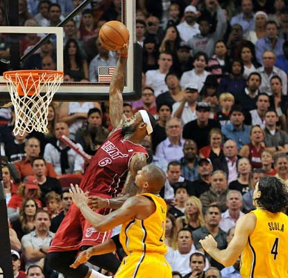LeBron James plays through a bad ankle to the tune of 24 points and the Heat even the season series vs. the Pacers.  (USATSI)