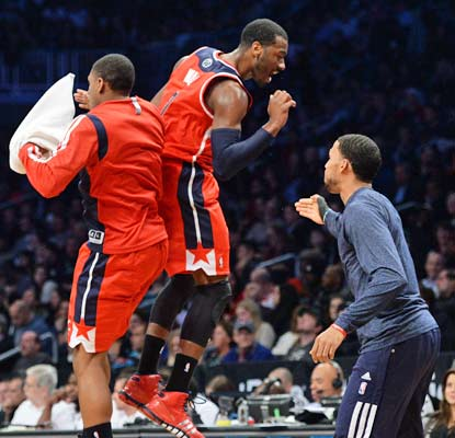 John Wall is pretty excited with his performance as he scores 21 points in the win over the Nets.  (USATSI)