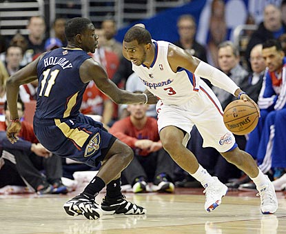Chris Paul drives on Jrue Holiday during the third quarter. Paul winds up with 12 points and 11 assists.  (USATSI)