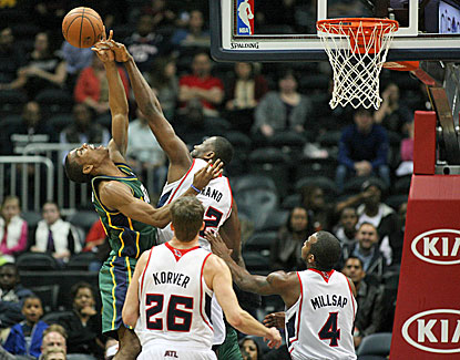 Atlanta's Elton Brand gets the block on Utah guard Alec Burks as the Hawks win their third straight. (USATSI)