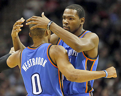Kevin Durant embraces Russell Westbrook, who goes off for 31 points and eight assists to help the Thunder win nine straight. (USATSI)