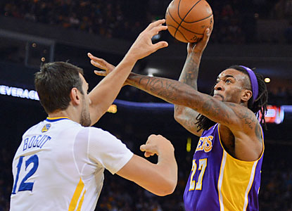 Jordan Hill and the shorthanded Lakers struggle against Andrew Bogut (20 rebounds) and the Warriors. (USATSI)
