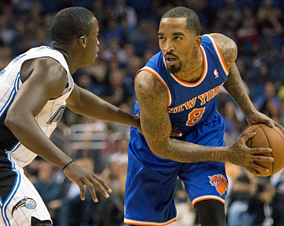 JR Smith scores 18 points and adds 10 rebounds and four assists as the Knicks survive the Magic's second-half rally. (USATSI)