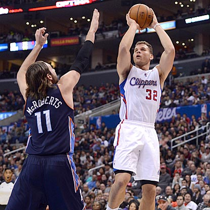 Blake Griffin, shown shooting over Josh McRoberts in the first half, gets hot late in the game to secure a victory for LA.  (USATSI)