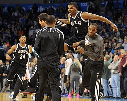 Joe Johnson and his teammates are understandably pumped after he beats the buzzer and the host Thunder with his shot.  (USATSI)