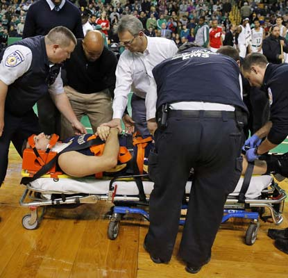 Ryan Anderson is injured in a collision with the Celtics' Gerald Wallace and needs to be hospitalized.  (USATSI)