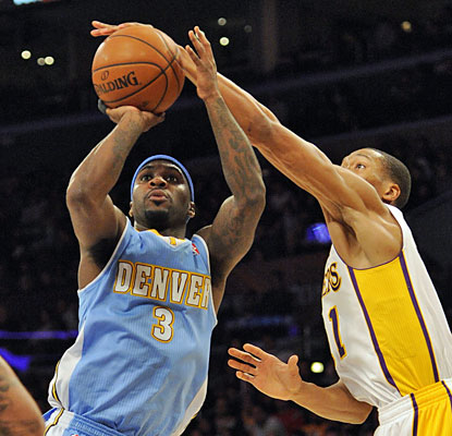 Ty Lawson (20 points, 12 assists) and the Nuggets pour it on against the Lakers, who lose seven of their past eight games. (USATSI)