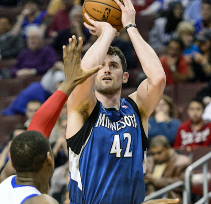 Kevin Love hits some big 3-pointers, fueling a third-quarter charge that propels the Wolves to a blowout win.  (USATSI)