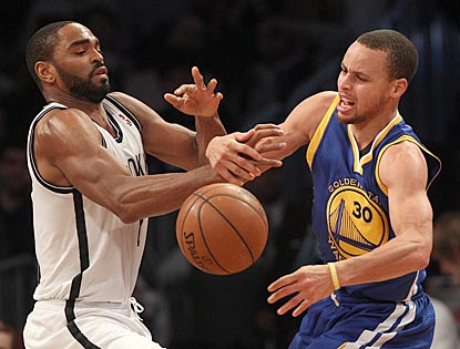 Stephen Curry and the Warriors try to match a franchise record, but Alan Anderson and the Nets get in the way.  (USATSI)