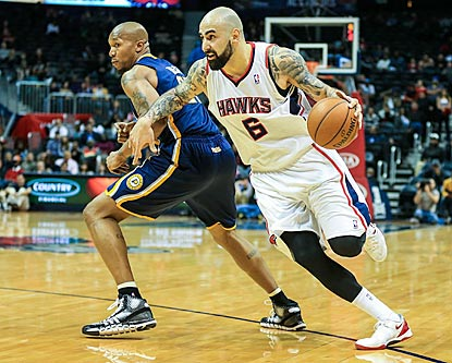 Pero Antic does a little of everything for Atlanta, like driving past David West here or knocking down a trio of 3-pointers.  (USATSI)