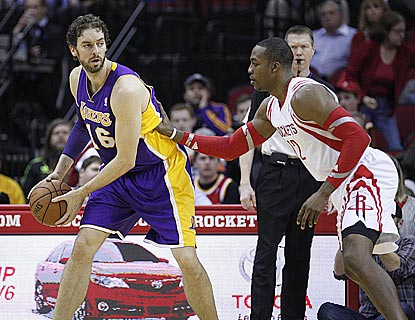 Former teammates Pau Gasol (21 points, 12 rebounds) and Dwight Howard (20 and 13) battle to a statistical draw.  (USATSI)