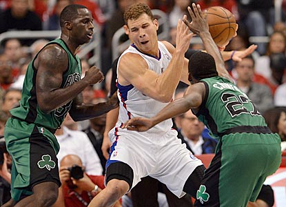 Blake Griffin tries to find room to maneuver between Boston defenders Brandon Bass (left) and Jordan Crawford.  (USATSI)