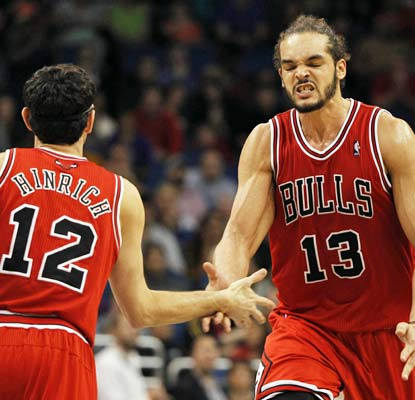 Joakim Noah collects a season-high 26 points as the Bulls manage a triple-overtime win in Orlando.  (USATSI)