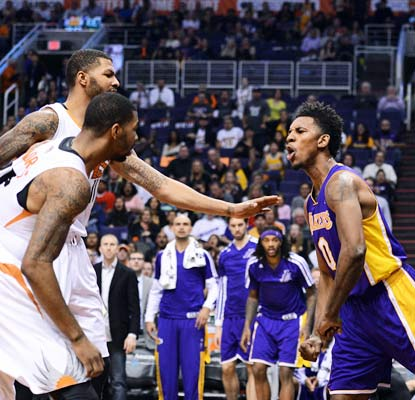 Nick Young reacts strongly after a hard foul from Alex Len (not pictured) and both are thrown out of the game.  (USATSI)