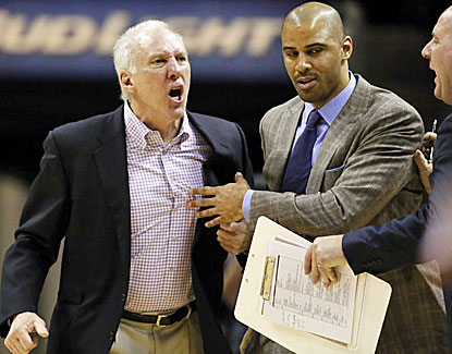 Spurs coach Gregg Popovich is less than thrilled with the officials after being tossed during a timeout. (USATSI)