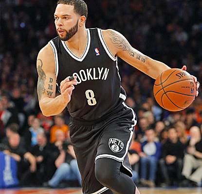 Deron Williams scores 13 points after returning from a five-game absence, and the Nets move to 7-1 in the new year.  (USATSI)