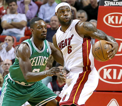 LeBron scores a game-high 29 points, including 11 in the fourth, to help the Heat avoid a collapse vs. the C's. (USATSI)