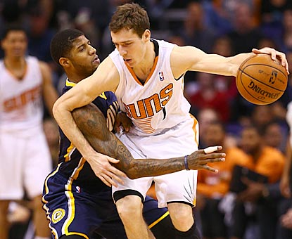 Paul George scores 26 points, but Goran Dragic scores 21 on 8-of-10 shooting to help keep the game out of reach.  (USATSI)