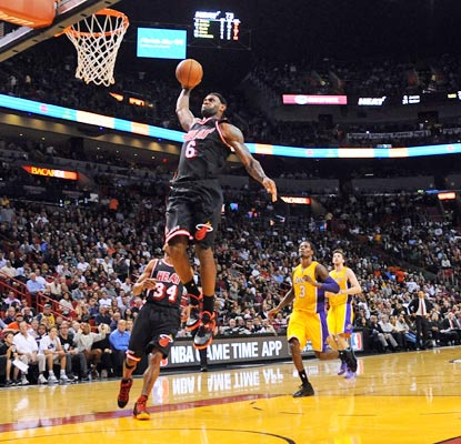 LeBron James flies in for the uncontested dunk. He drops 27 points and 13 rebounds on the outmanned Lakers.  (USATSI)
