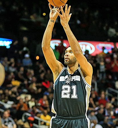 Tim Duncan goes for 17 points and 16 boards, dominating the shorthanded Hawks in an easy Spurs victory.  (USATSI)