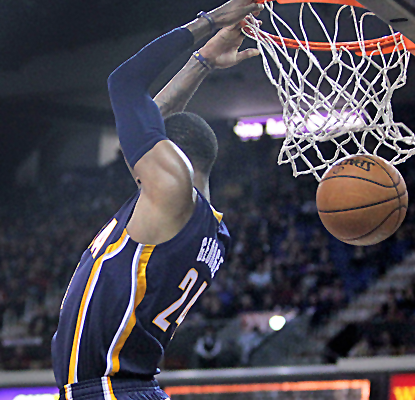 Paul George has another huge night, throwing down this reverse dunk for two of his 36 points in Sacramento.  (USATSI)