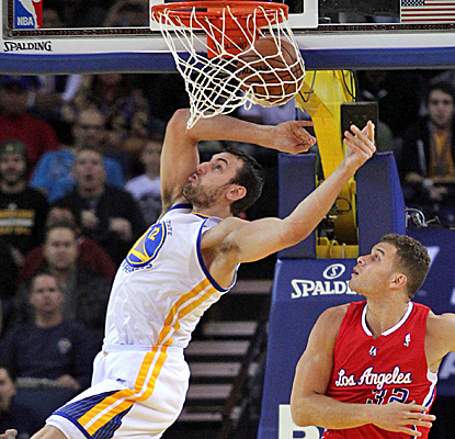 Andrew Bogut throws down this alley-oop, but it's his 17 rebounds that really swing the tide for the Warriors.  (USATSI)