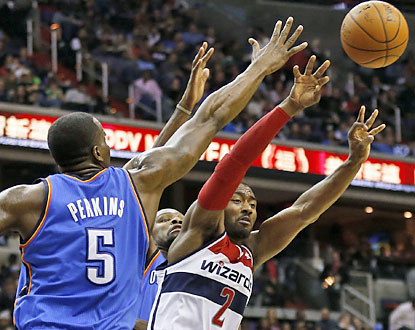 John Wall dishes out 15 assists as he and the Wizards do more than enough to cool off the red-hot Thunder. (USATSI)