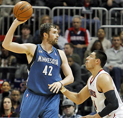 Kevin Love does all he can with 43 points and 19 rebounds, but it's not enough to save the Wolves from defeat.  (USATSI)