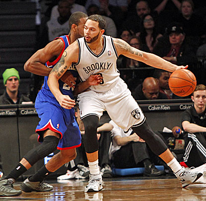 Brooklyn's Deron Williams (right), who scores 21 points, fights for position against Philadelphia's Elliot Williams. (USATSI)