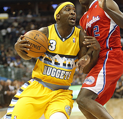 Ty Lawson returns from a shoulder injury to score 27 points, and the Nuggets pull out a wild win at the buzzer.  (USATSI)