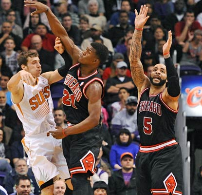 The Bulls' smothering defense holds the high-powered Suns to 13 points below their scoring average.  (USATSI)