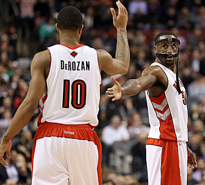 Patrick Patterson (right), who scores a season-high 22 points during the win, is congratulated by DeMar DeRozan. (USATSI)